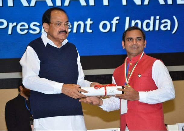 Dr. Srinubabu Gedela receives 'Champions of Change' Award from Vice President of India