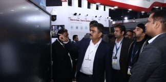 Ashish P. Dhakan, MD & CEO, Prama Hikvision India showing the Hikvision's newly launched product Interactive Screen to the delegates at IFSEC India 2019