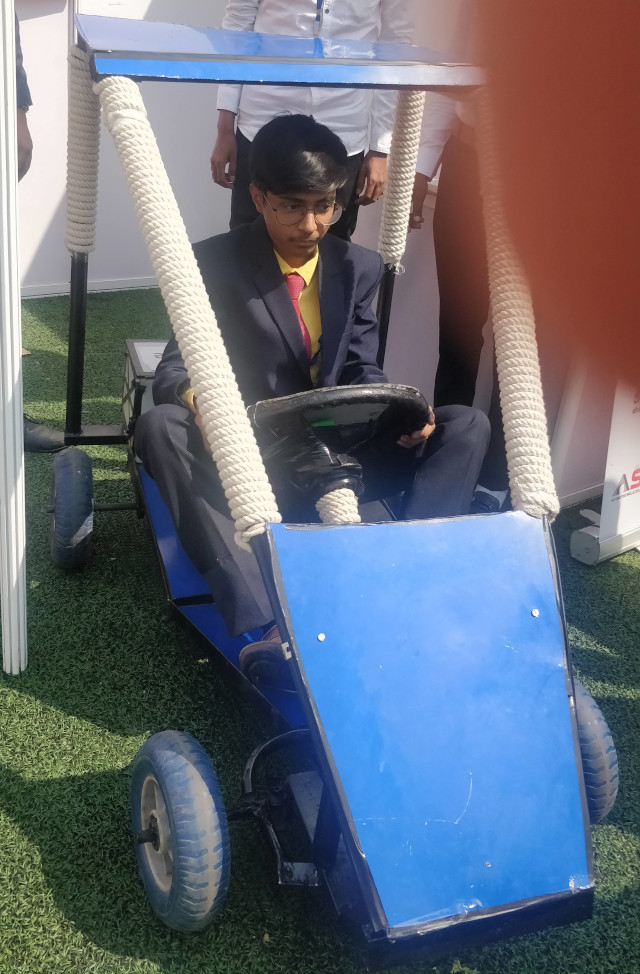 Student showing his Electric Go- Kart