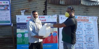 M3M Foundation distributing food packets under IMPower program